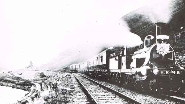 Royal Train conveying King Edward V11 skirting Loch Oich near Invergarry Station